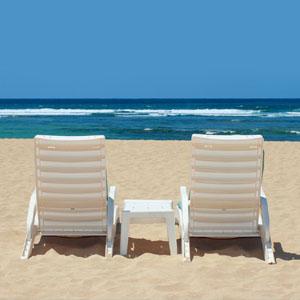 Two beach chairs facing the ocean