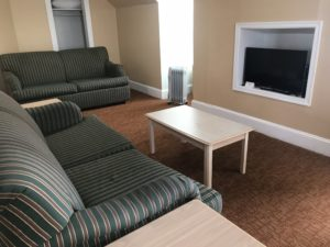 A TV in front of a sofa