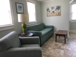 A coffee table in front of a sofa and chair