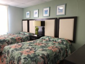 Two floral beds with padded headboards