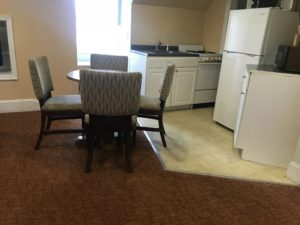 Tables and chairs in the middle of the kitchen