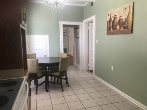 Two doors beside a dining table