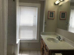 A bathroom window with blinds