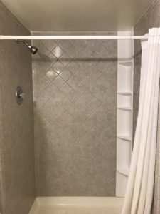 A shower with a curtain