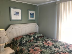 A floral bed with white headboards