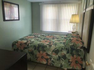 A floral bed in a small room