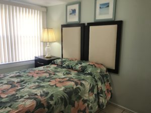 A bed with hanging headboards