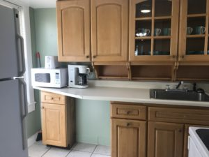 A microwave and coffeemaker on a kitchen counter