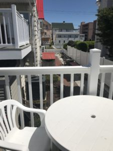 A white table and chairs on a balcony