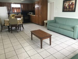 A small coffee table in the middle of a living room