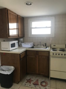 A kitchen with brown cabinets