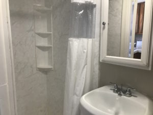 A bathroom cabinet above a sink