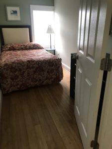 A bedroom and an open door