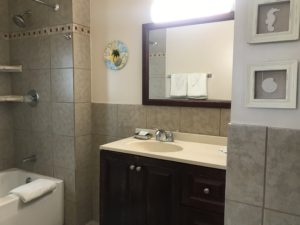 A bathtub beside a sink
