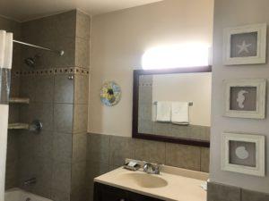 A bathroom sink with a mirror